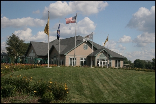 University Park Golf Club clubhouse small image with flags
